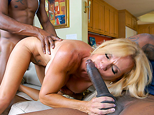 Horny MILF takes on 2 basketball studs image 5