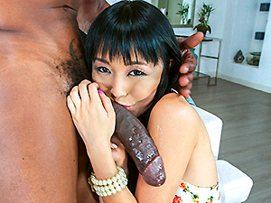 Giggly Marica Hase marveling at a huge black cock image 3